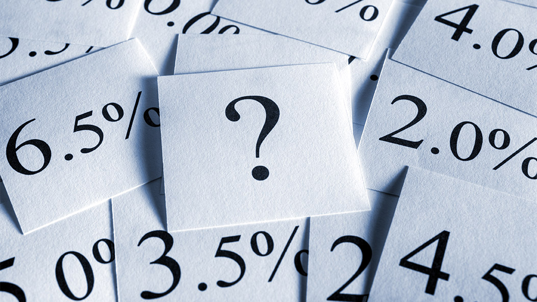 Paper printed with percentages and a question mark